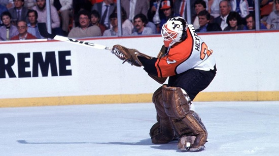 https://explosivefemalehockey.com/wp-content/uploads/2020/12/Ron-Hextall-shoots-and-scores-first-nhl-goalie-goal.jpg